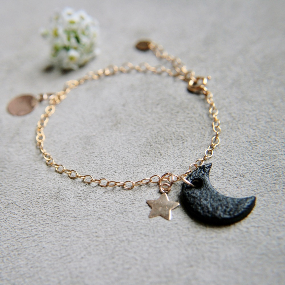 Gold bracelet with smooth discs & porcelain moon