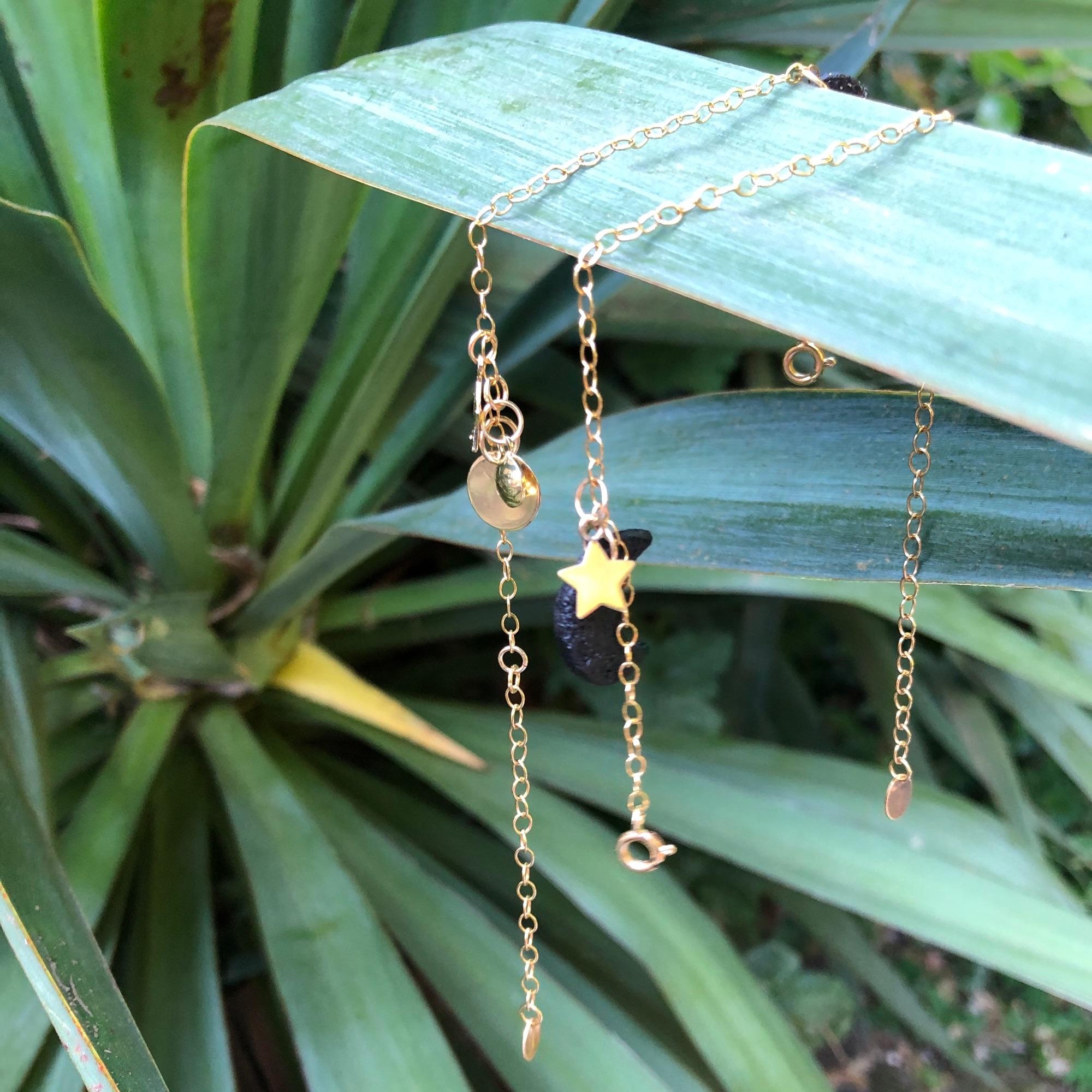 gold bracelets hanging from the leaf