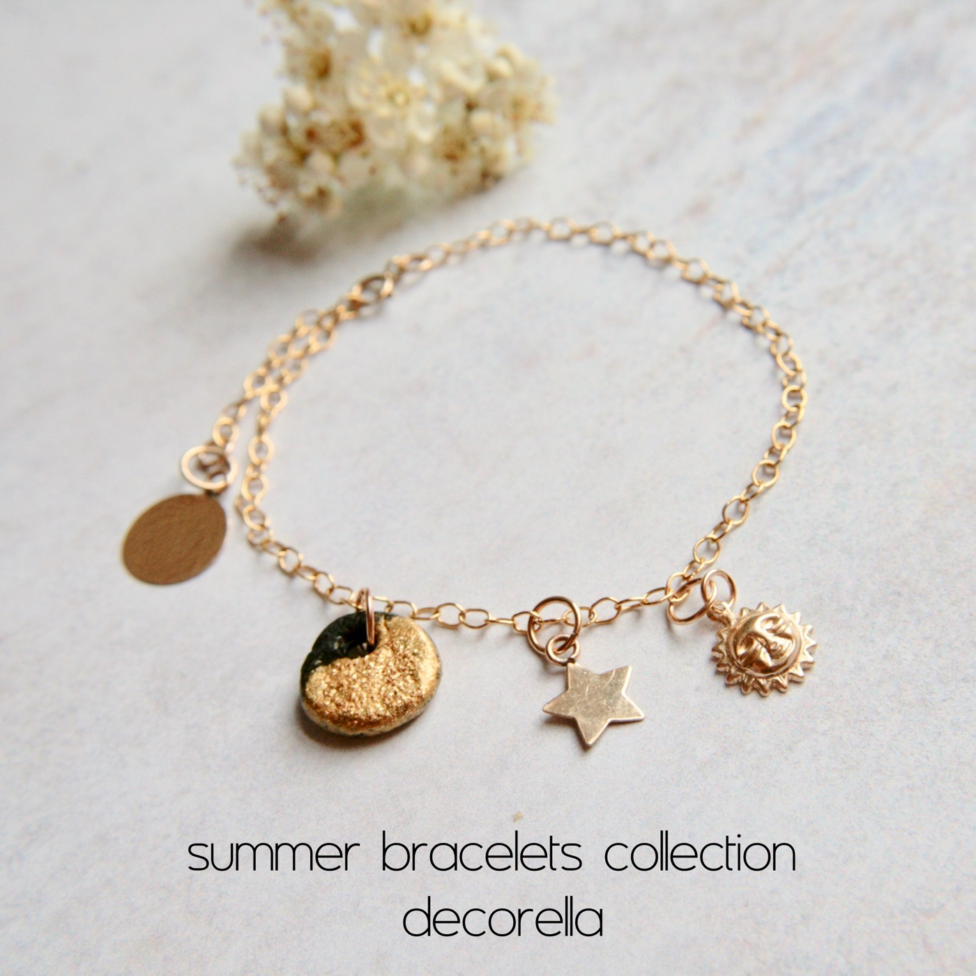gold bracelet with sun charm