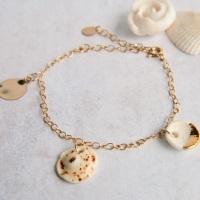 Gold bracelet with handmade porcelain shells