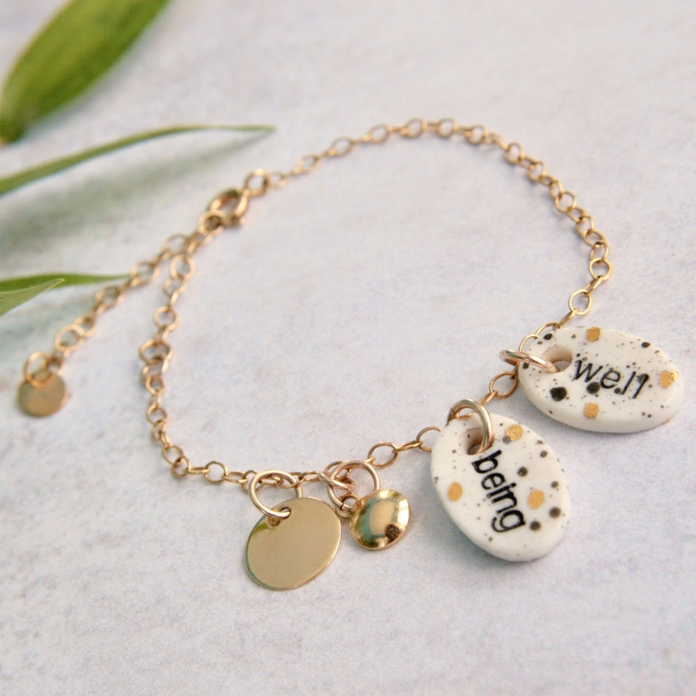 Wellbeing bracelet with handmade porcelain charms