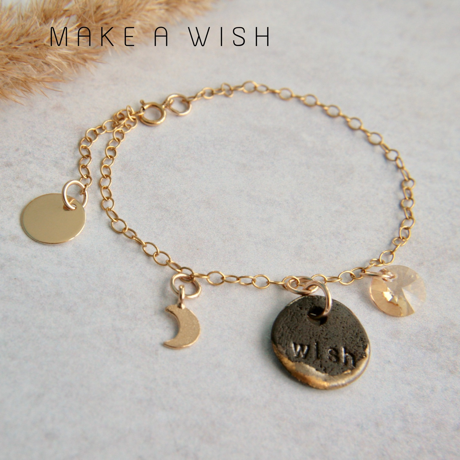 gold bracelet with handmade charms