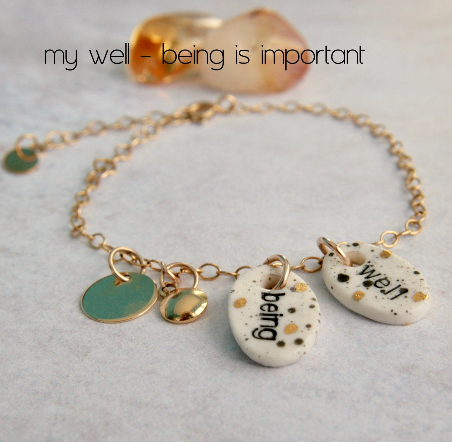gold bracelet with charms