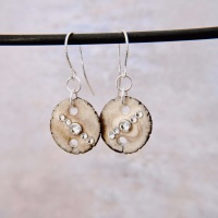 Porcelain earrings with crystals.