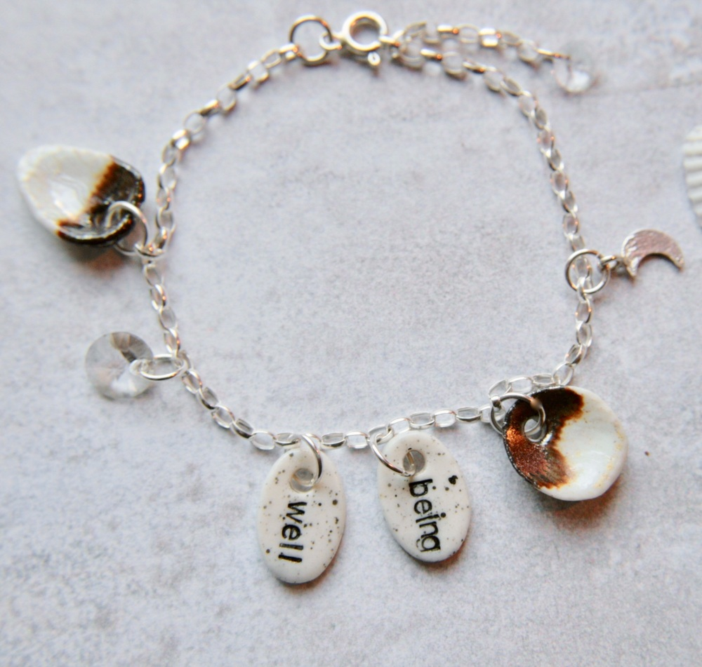 Wellbeing  charm bracelet - sterling silver