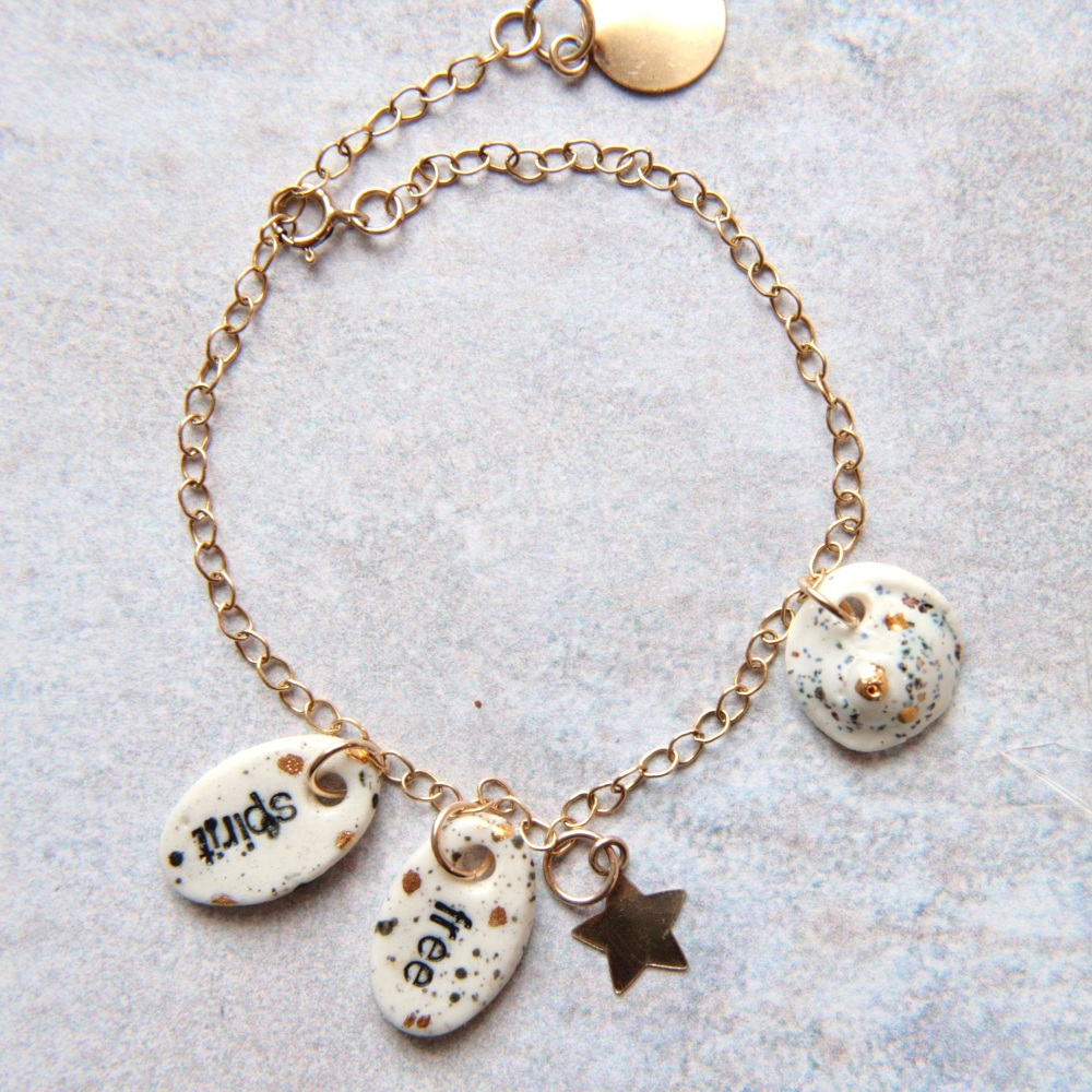 Free spirit bracelet with handmade porcelain charms