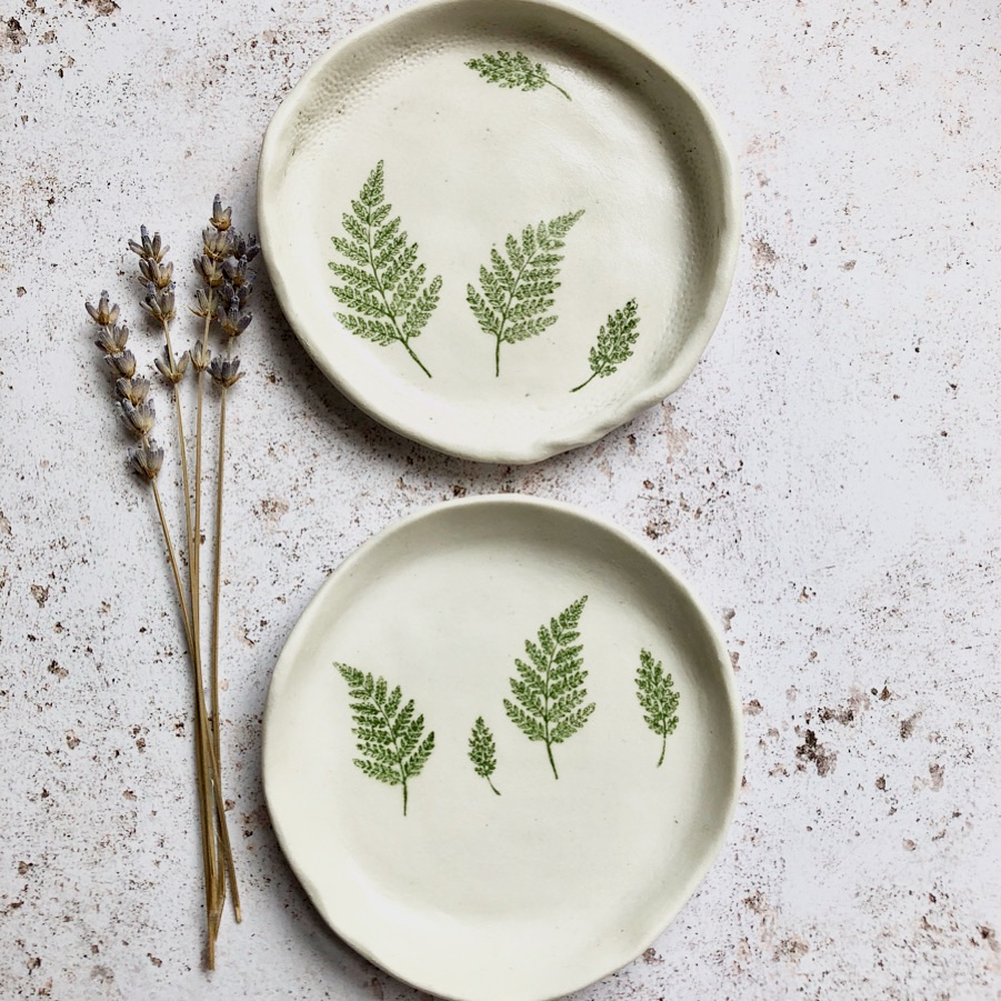white small ceramic dish with fern print
