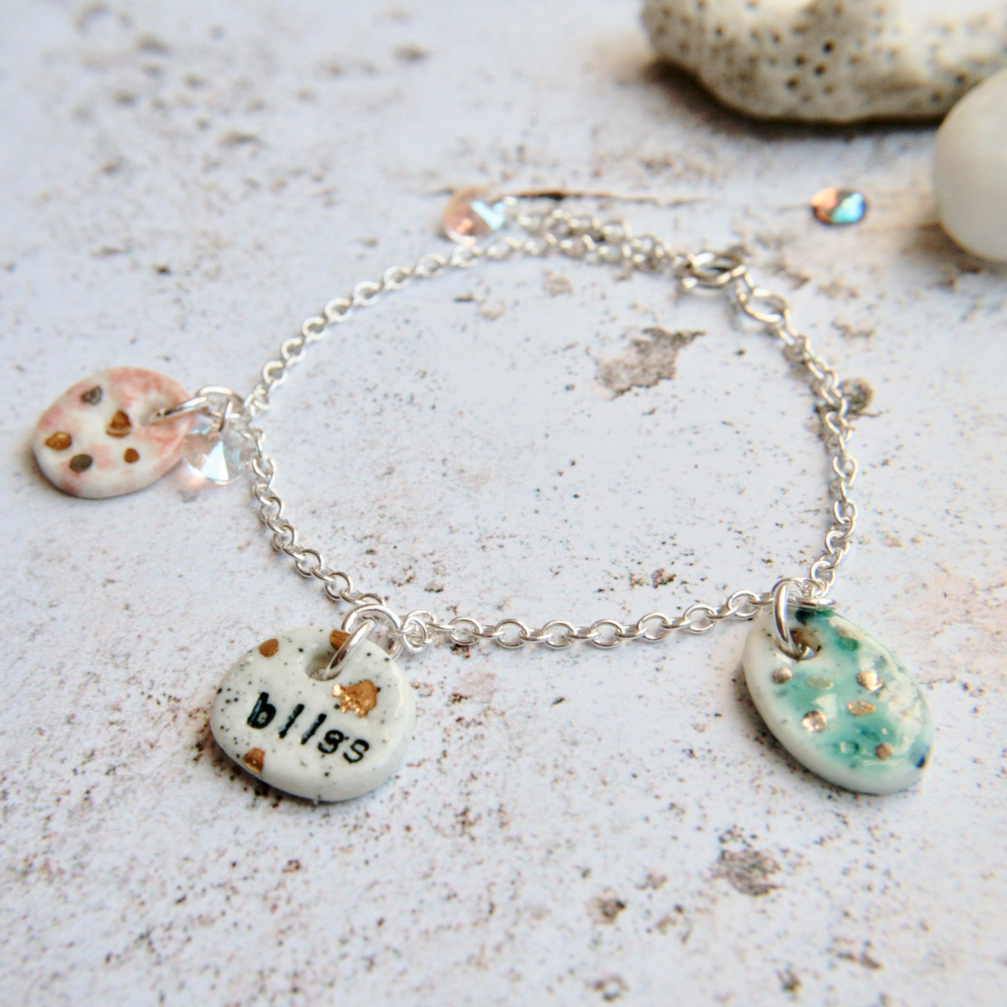 silver bracelet with handmade charms