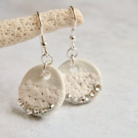 Porcelain earrings adorned with crystals.