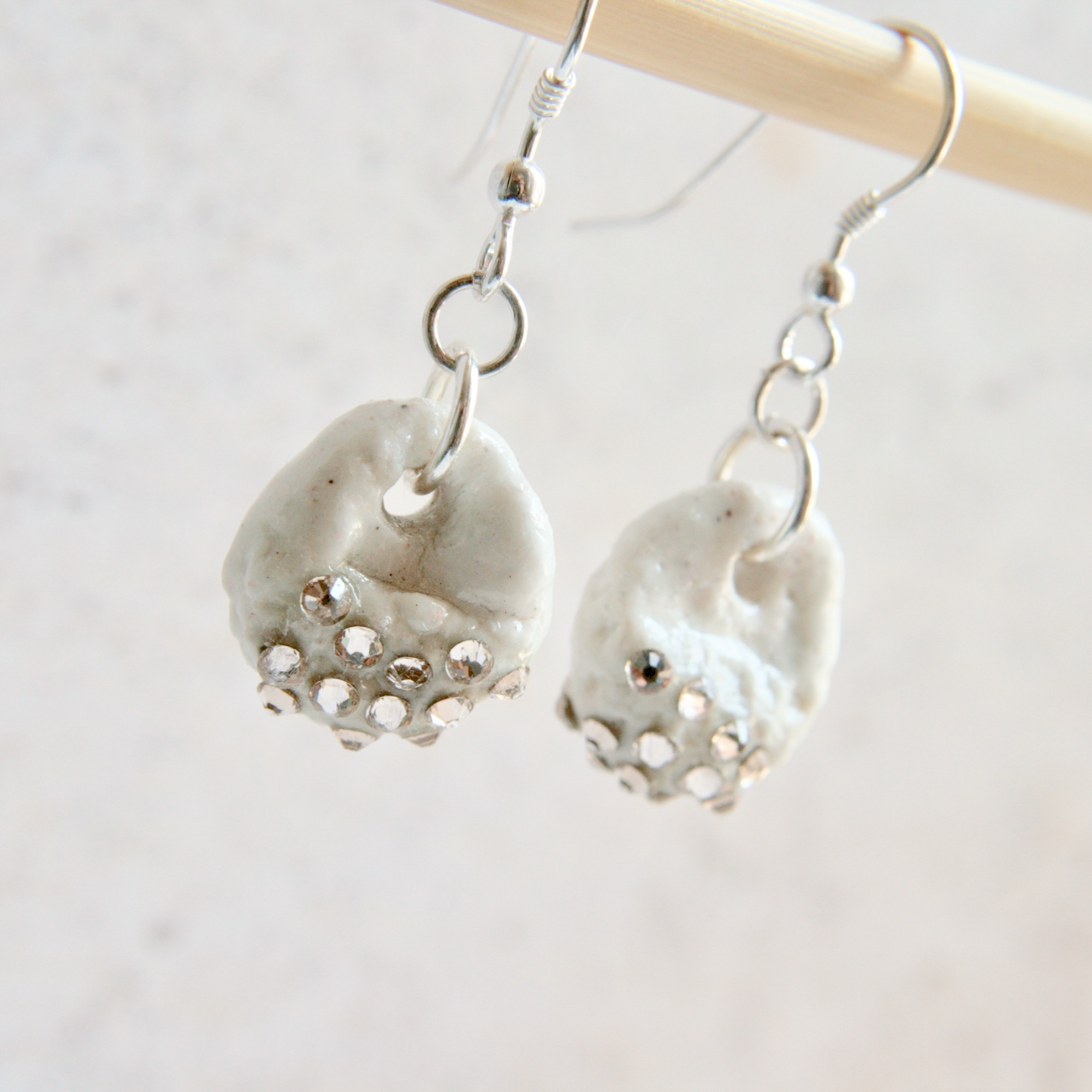 crystal-embellshed porcelain earrings with organic texture