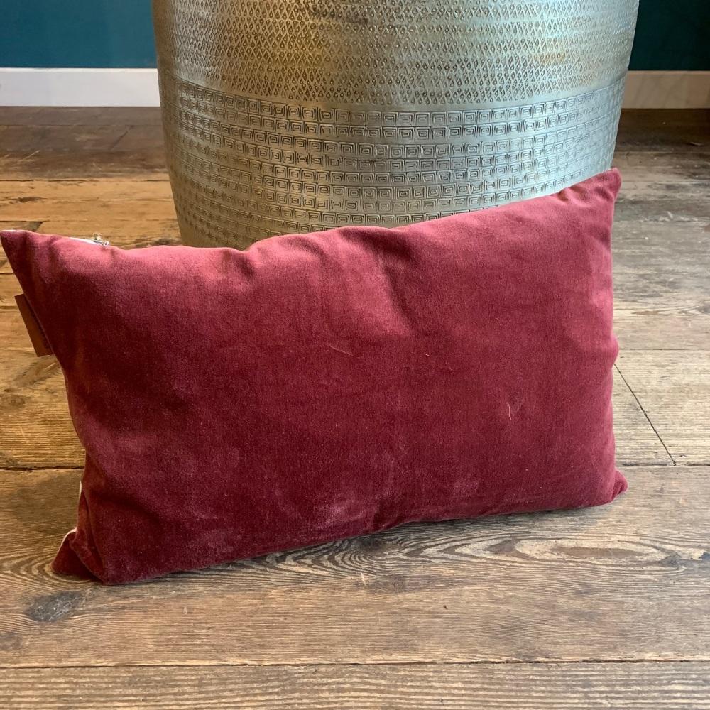 Oblong burgundy cushion