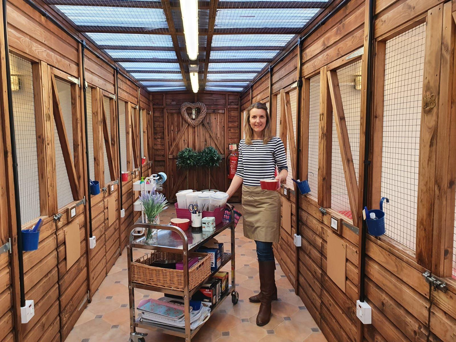 Nicola delivering meals to feline guests at Kingstone Pet Boarding