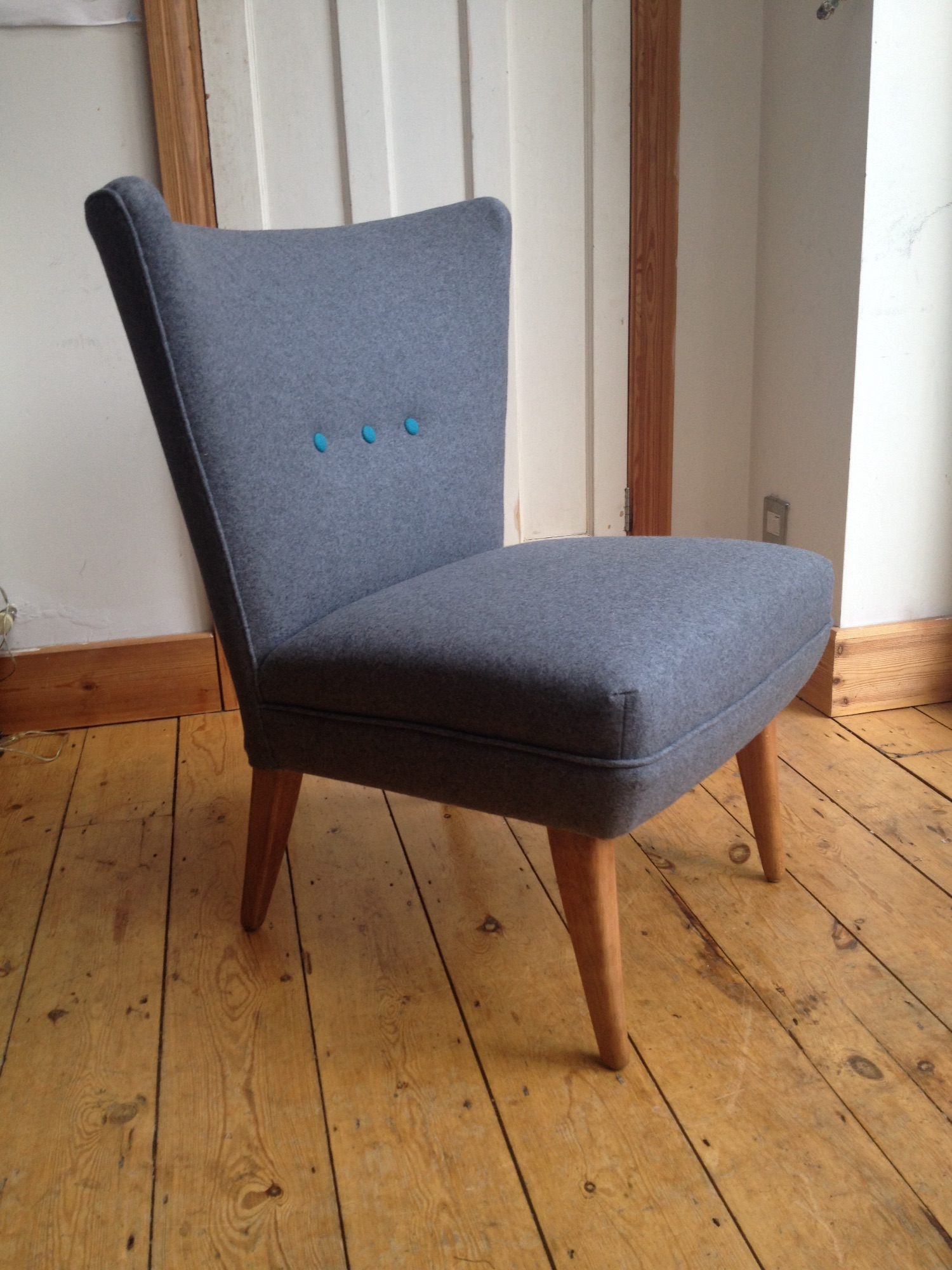 Howard Keith chair by Spring Upholstery Brighton in grey wool felt fabric with contrasting turquoise buttons