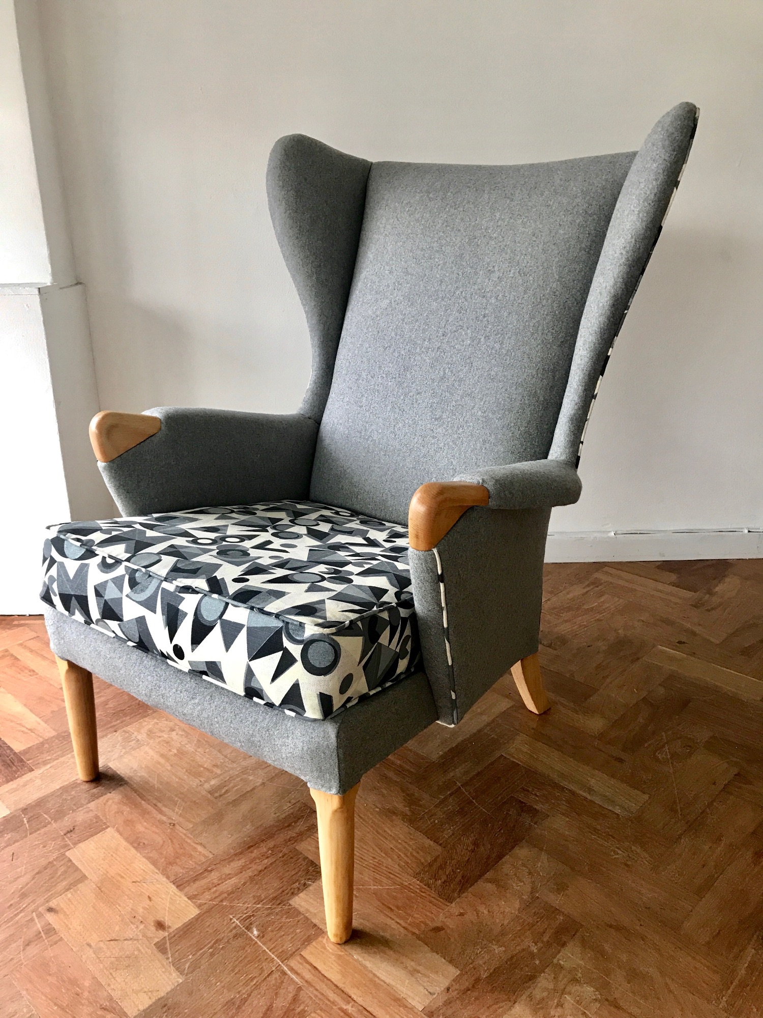 Vintage Parker Knoll 'papa bear' winged armchair by Spring Upholstery Brighton in grey wool felt and Colourdrome fabric desinged by Peter Green and produced by  St Jude's Fabrics
