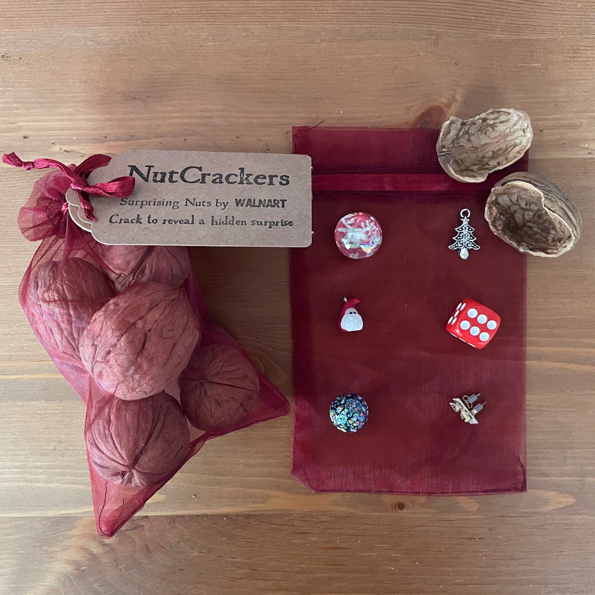 NutCrackers - Assorted Christmas Walnut shell surprise crackers in a burgundy organza bag - contents.jpg