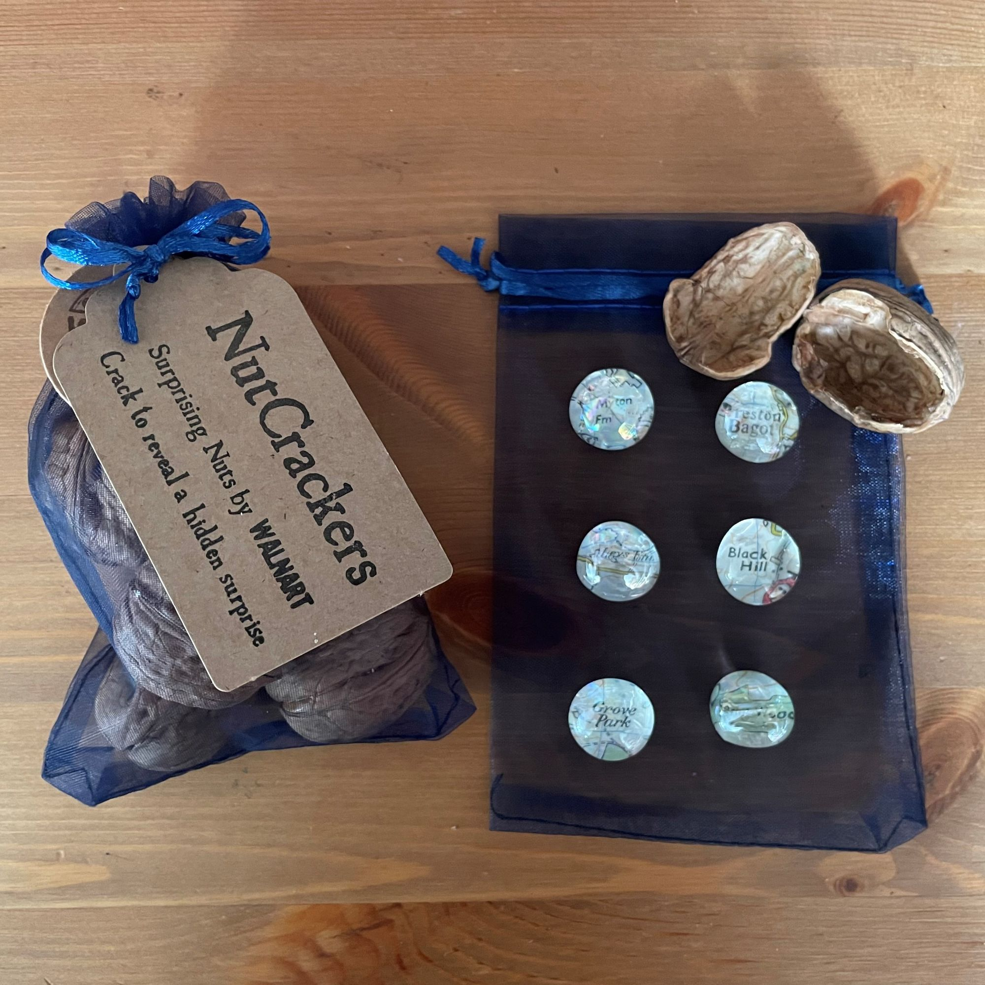 NutCrackers - Walnut shell surprise crackers with map magnets in blue organza bag contents.jpg