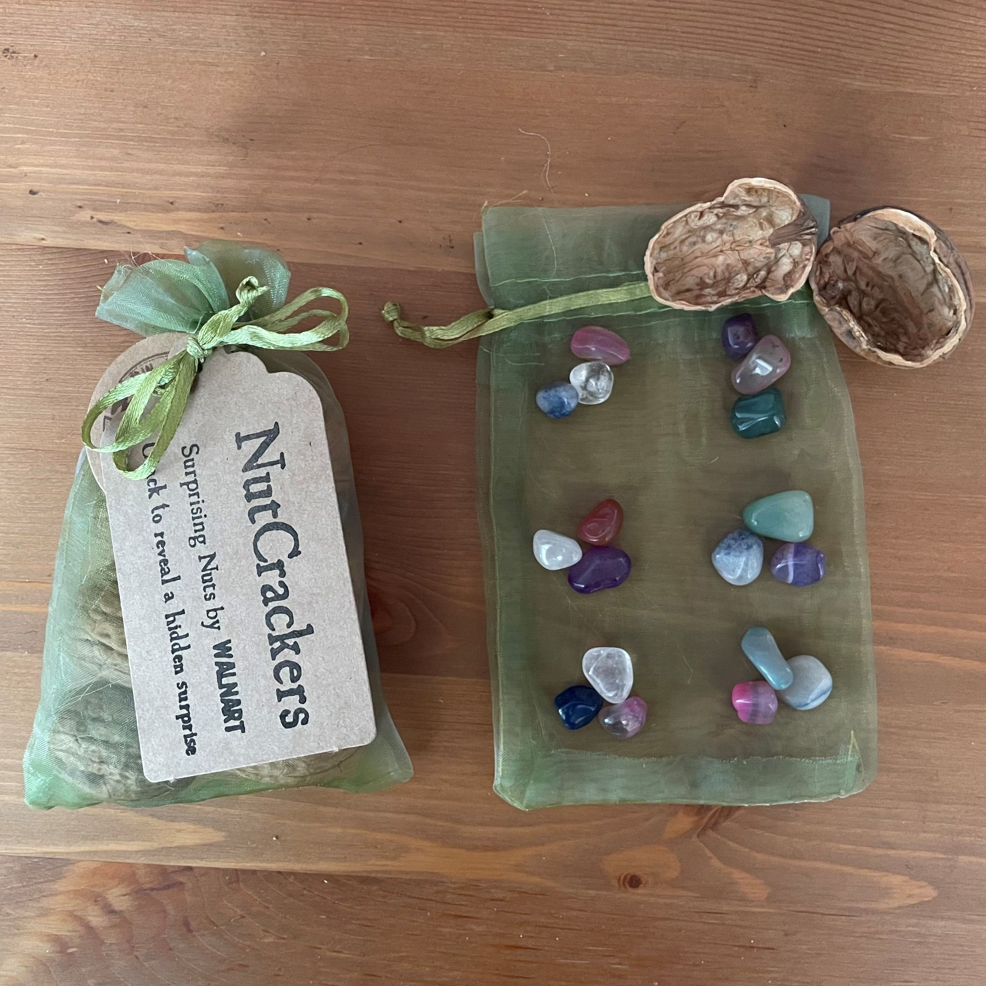 NutCrackers -   Walnut shell surprise crackers with polished stones in a green organza bag - contents.jpg