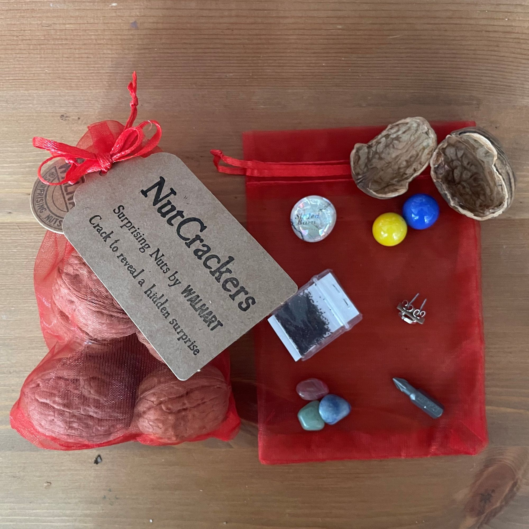 NutCrackers - Assorted Walnut shell surprise crackers in a red organza bag - contents.jpg
