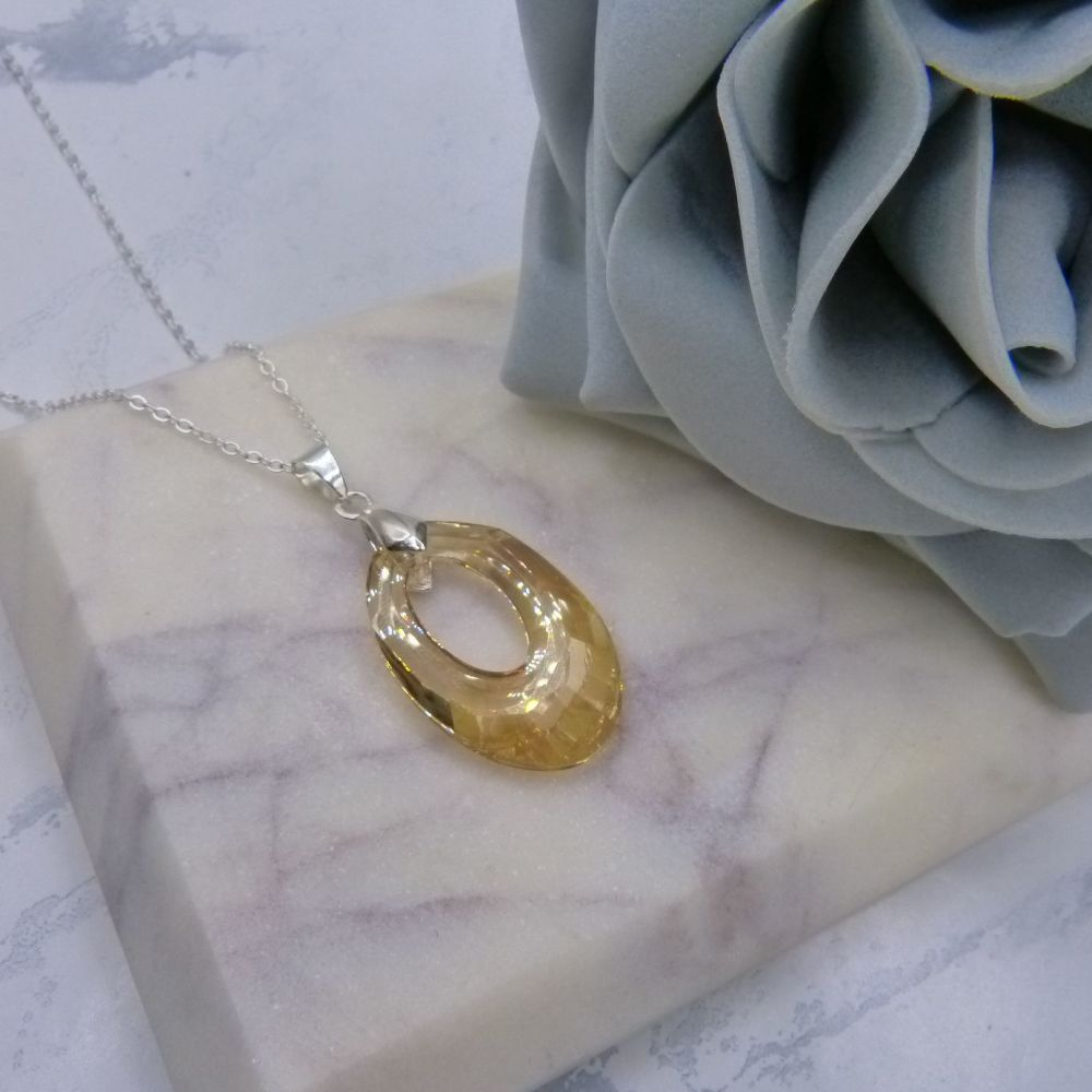 Large Golden Shadow Hollow Oval Pendant