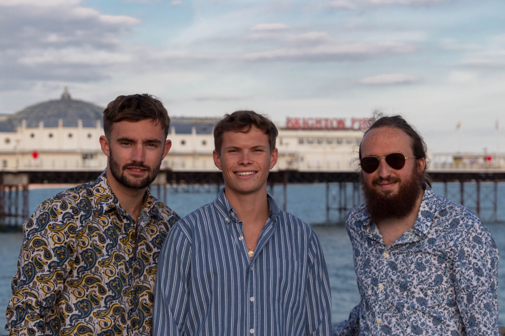 A picture of the three Ethicul founders on Brighton Seafront