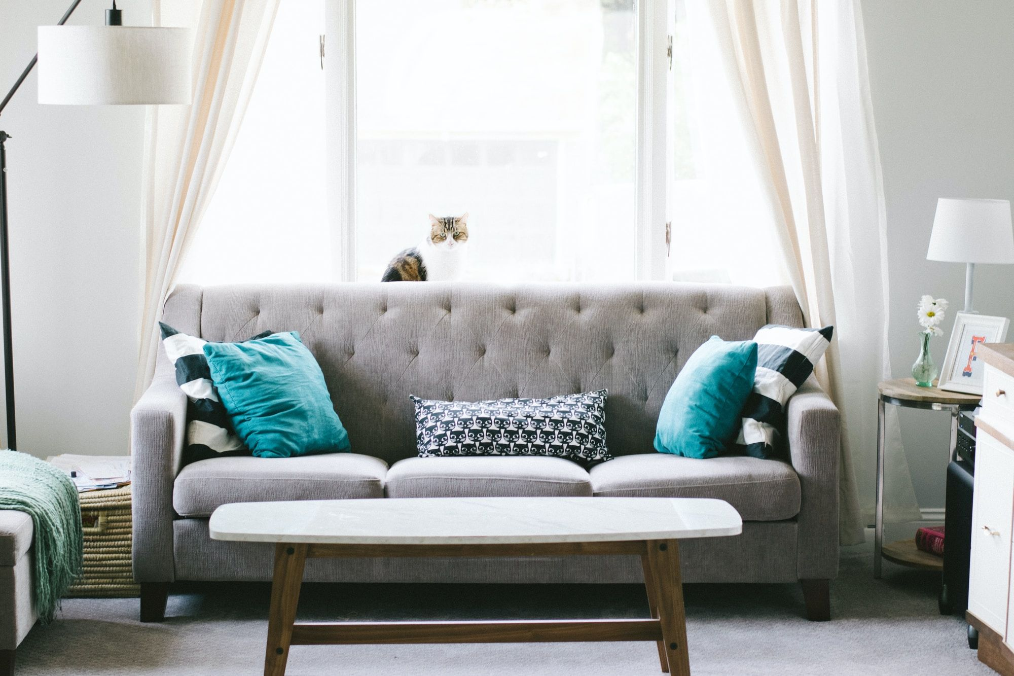 A grey couch situated in a living room
