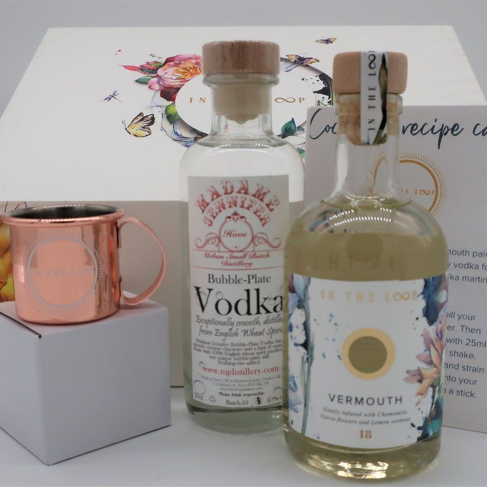 A dirty vodka martini cocktail box by In The Loop. Containing Vodka, Vermouth and a cocktail jigger