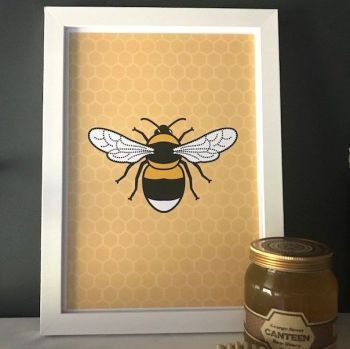 A bright & colourful framed Bee print made by the team at Tommy & Lottie