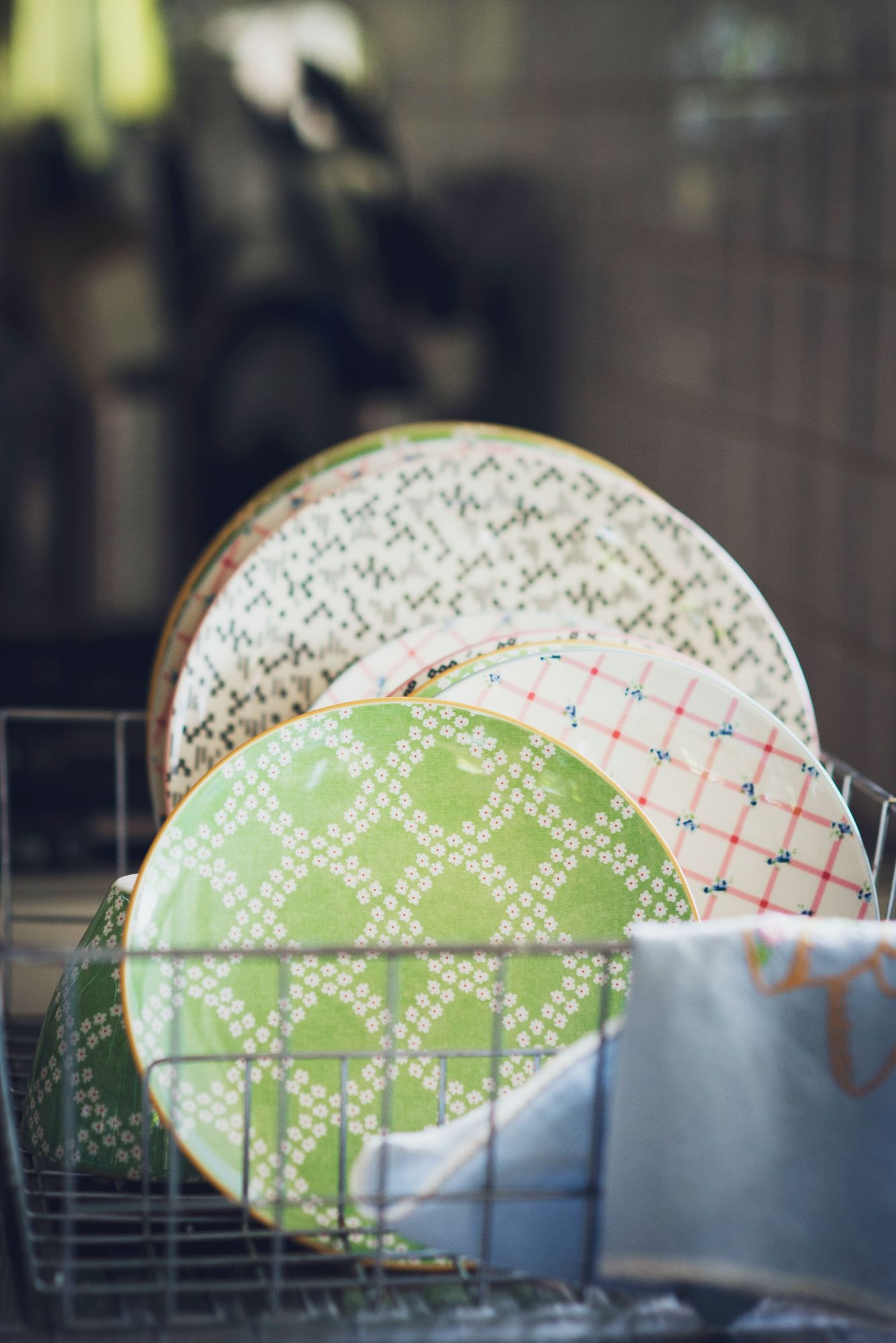 Plates on a drying rack in a kitchen