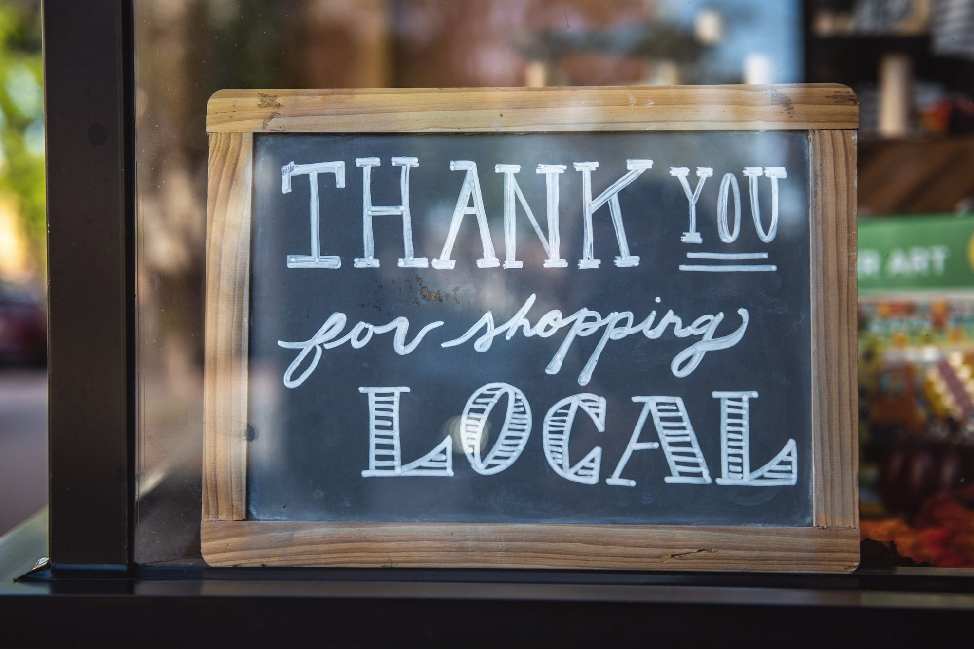 A sign stating thank you for shopping local