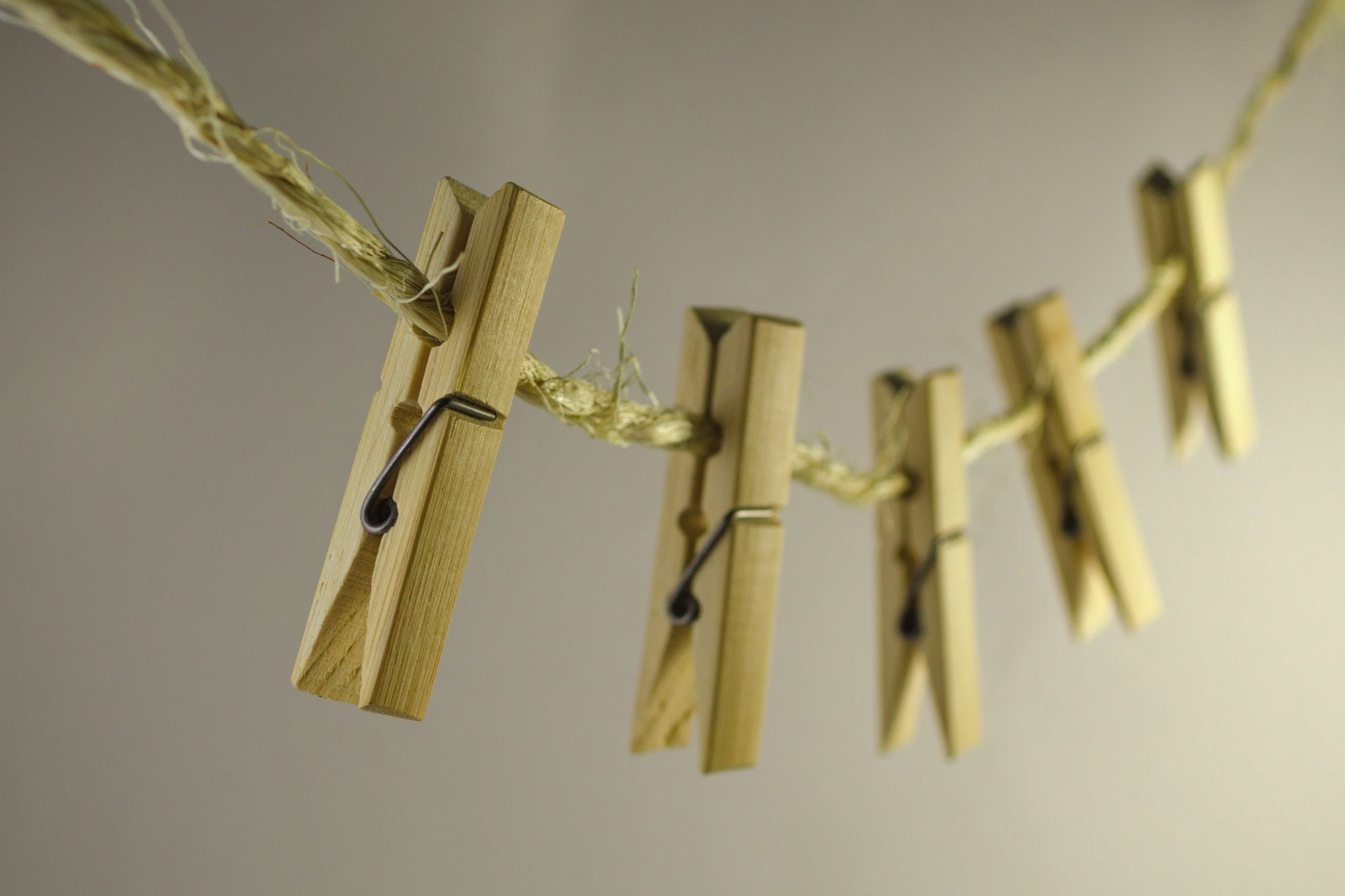 Wooden pegs on a washing line.
