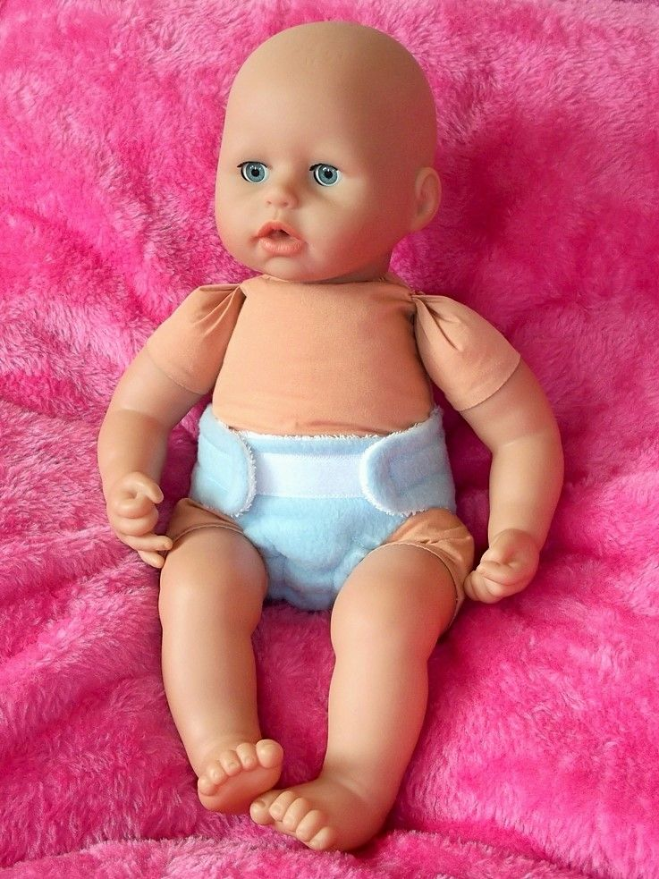 Doll wearing a blue nappy