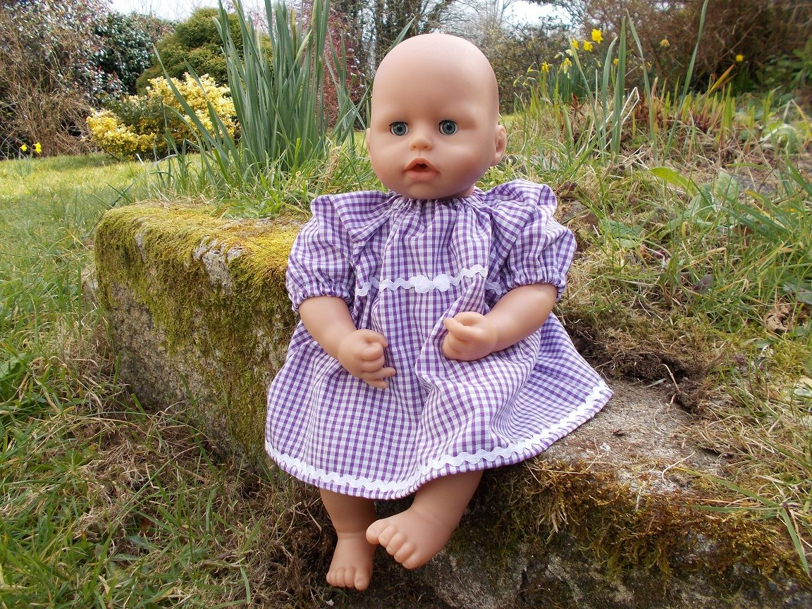 Doll wearing a school dress in the garden