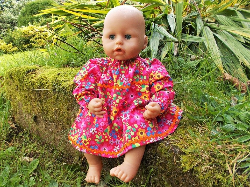 Doll wearing a pink flowery dress