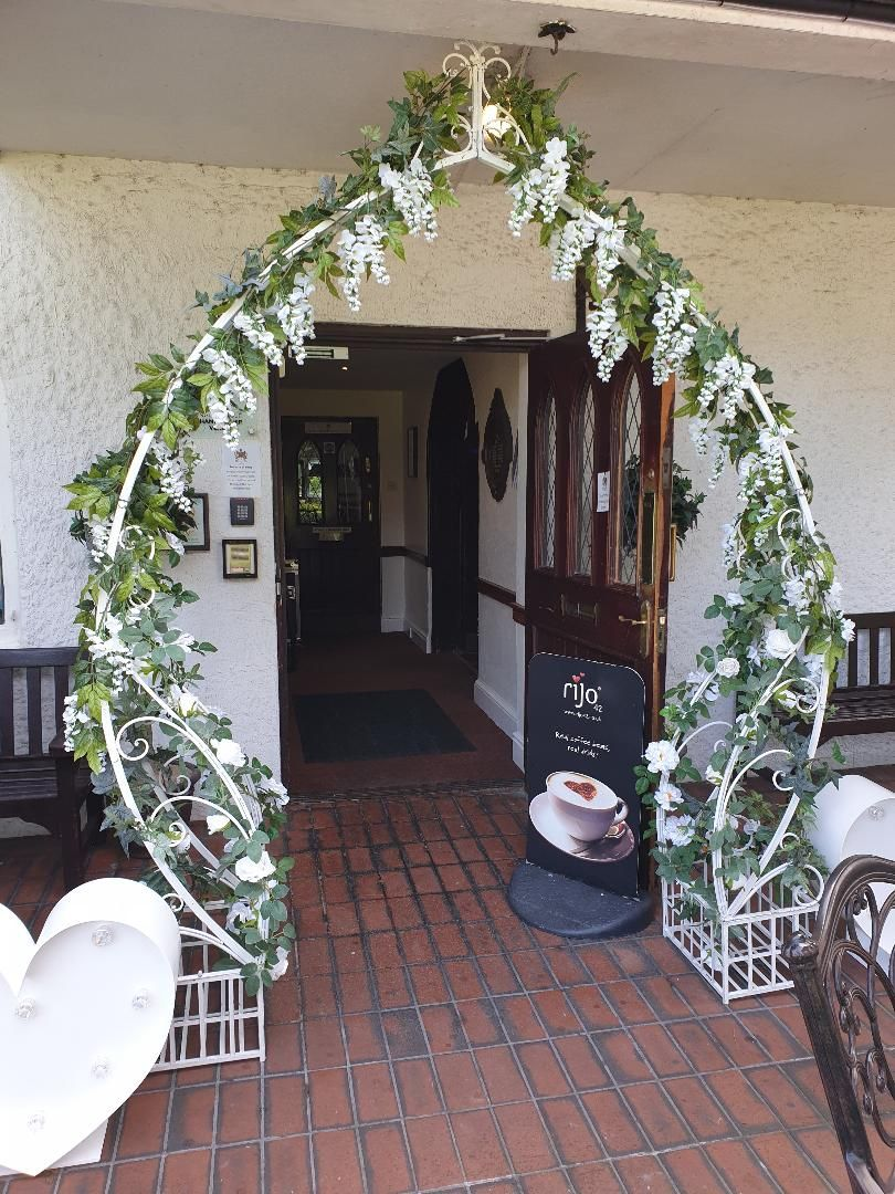 Floral Arch with Wisteria and Roses