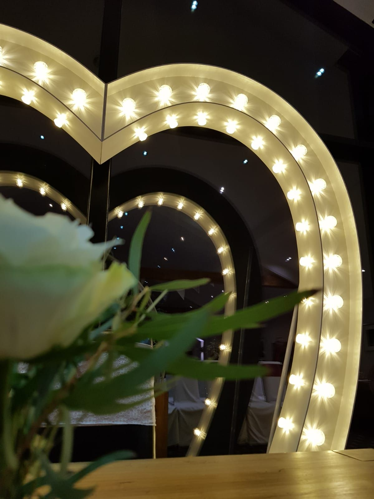 Close Up of Love Heart Arch in Front of Window