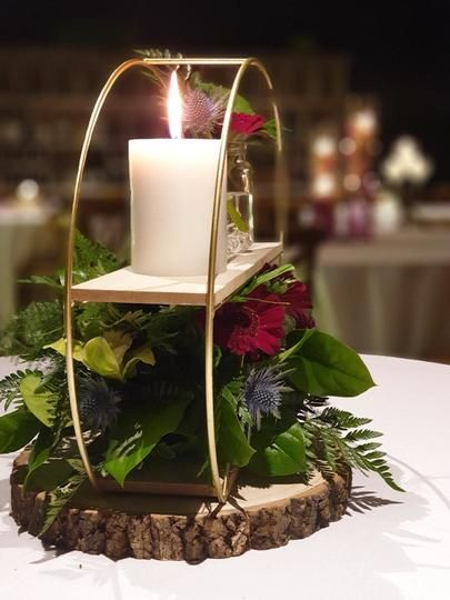 Circle Centrepiece with flowers and Candle on Log Slice