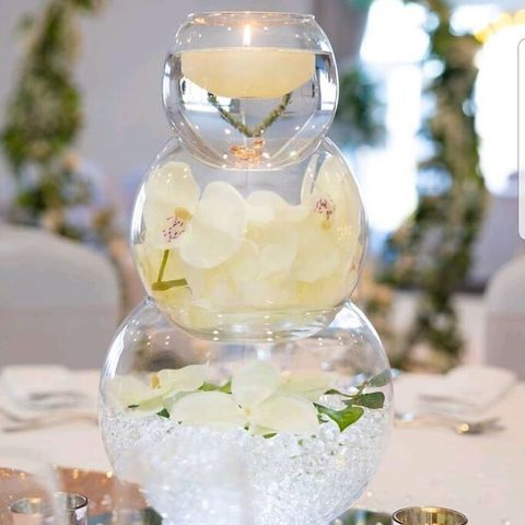 Fishbowl Centrepiece with Orchids and Floating Candle