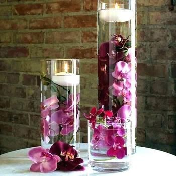 Cylinder Centrepiece with Pink Orchids and Floating Candles