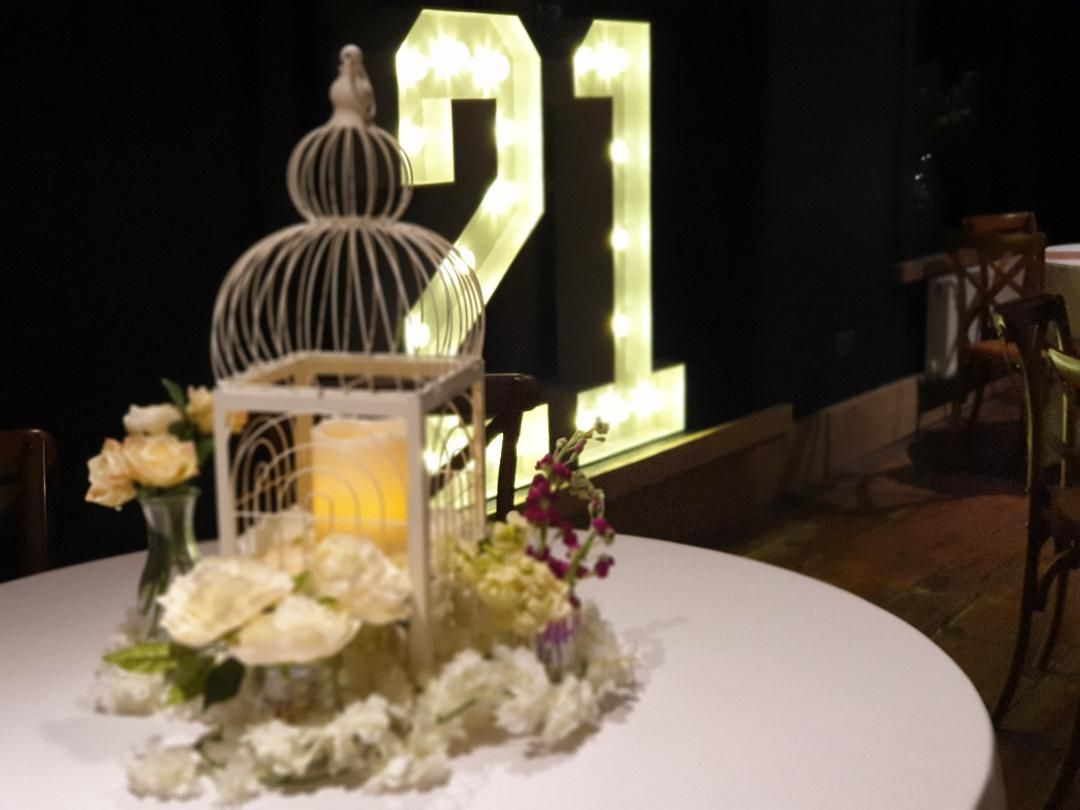 Birdcage Centrepiece With Various Vases and Flowers