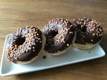 CHOCOLATE COATED RING DONUTS - TOPPED WITH NUTS - 3 PACK