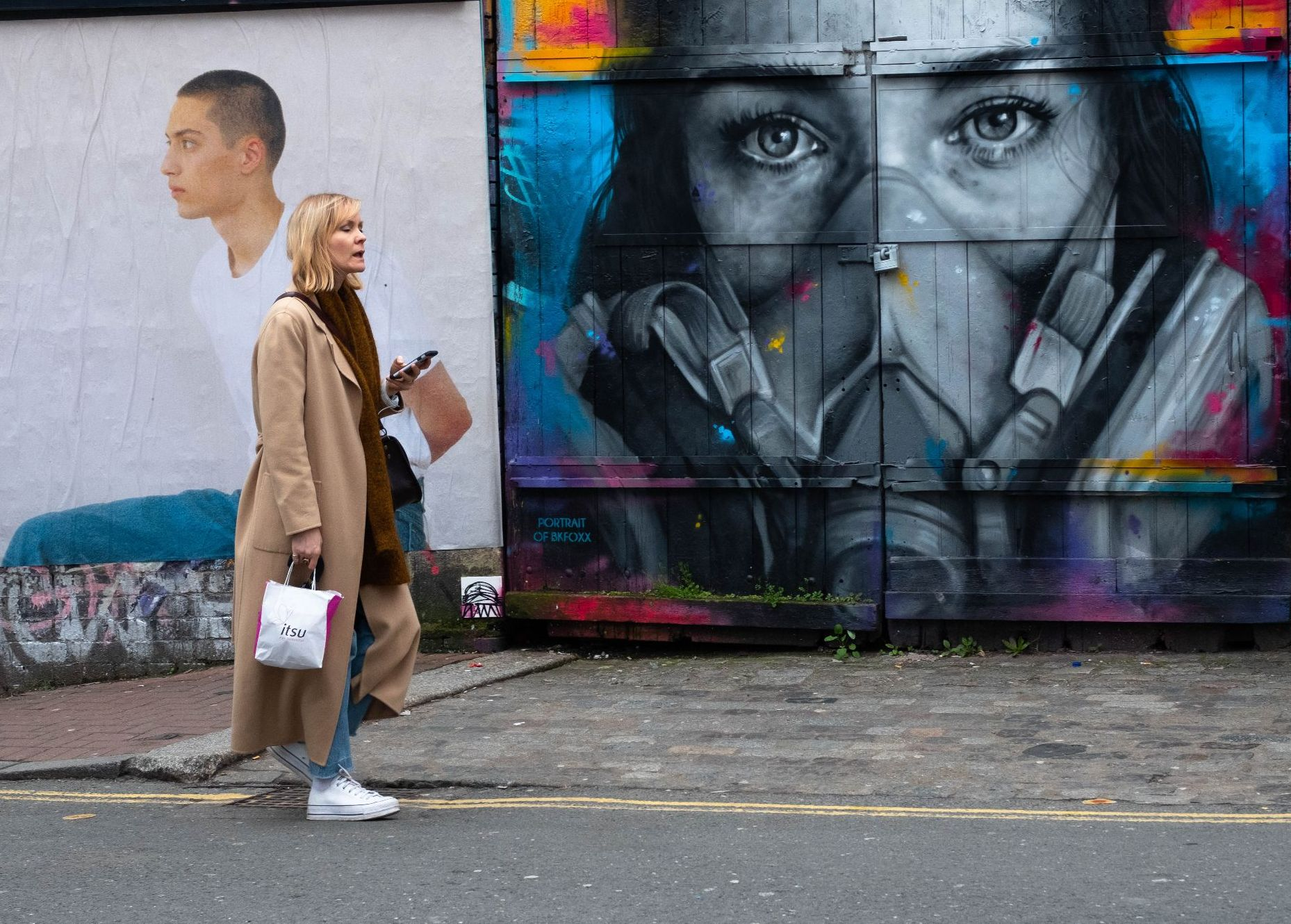 blacn and white woman in face mask street scene grafitti