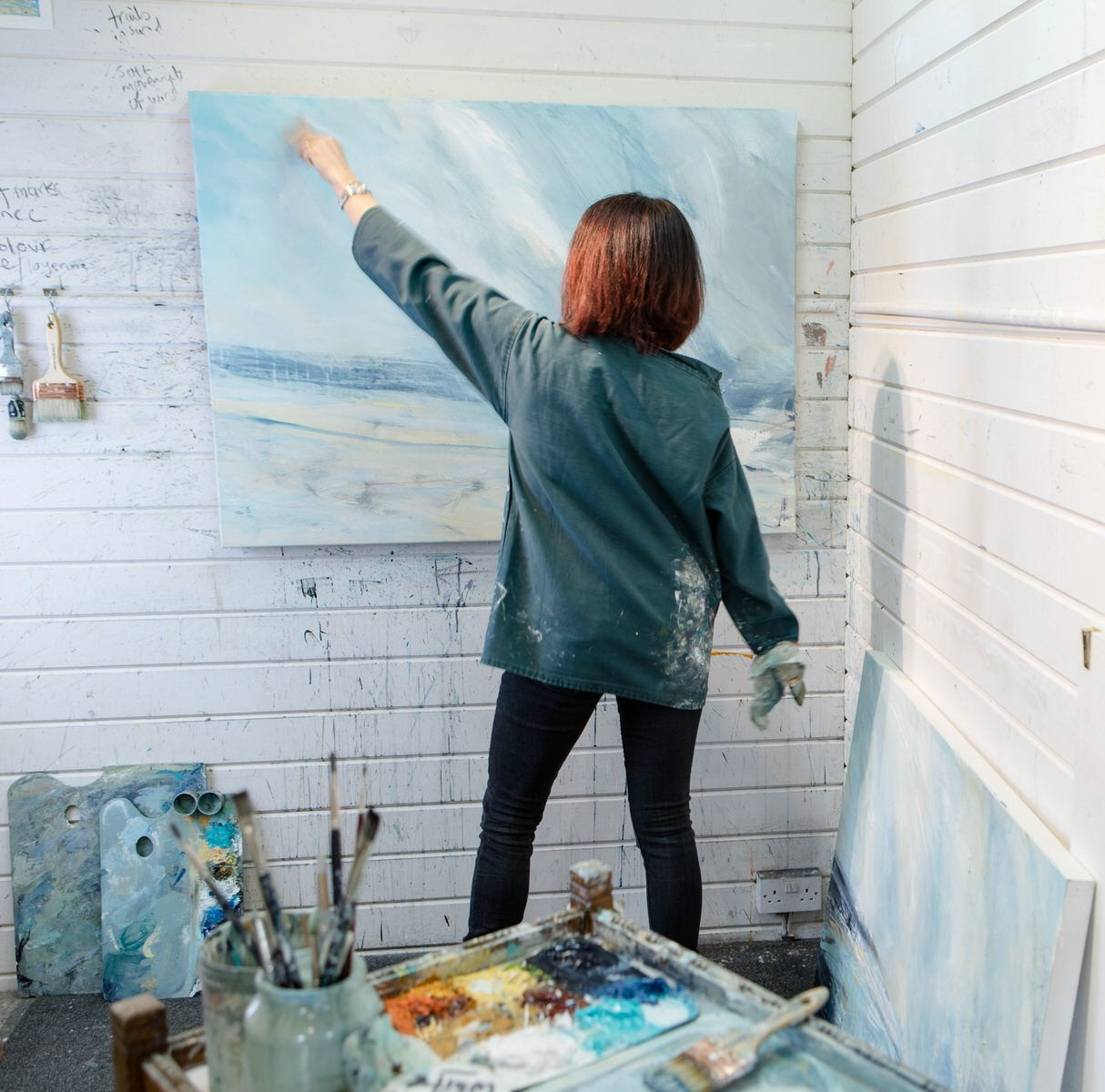 Alison painting in studio