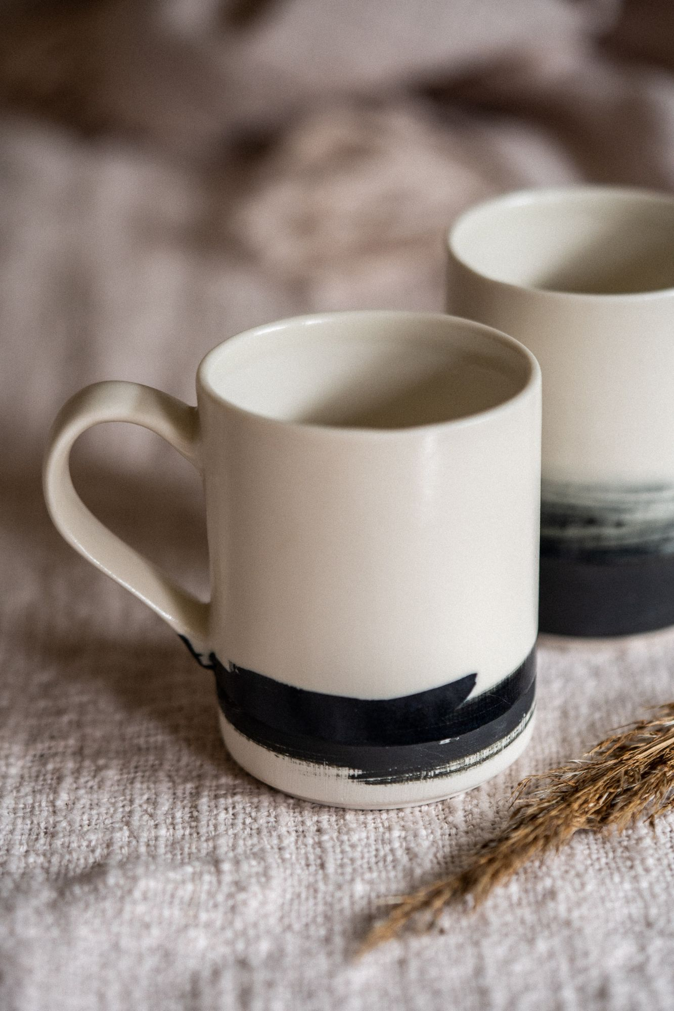 Cream mug with black brush mark