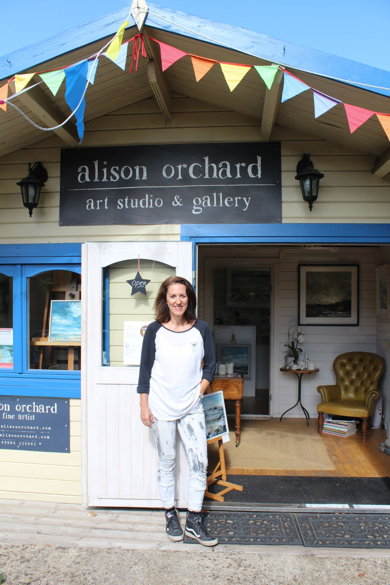 Alison standing outside her gallery