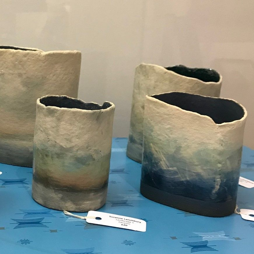 rough edged vases with seascape on sides