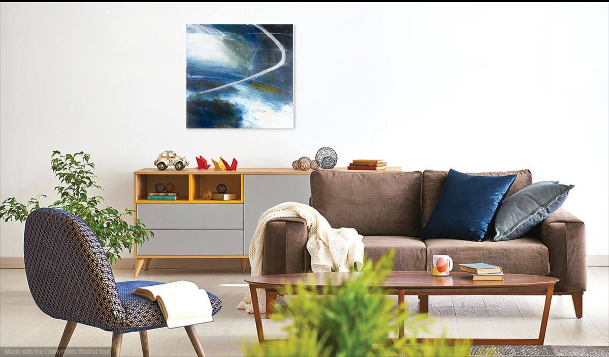 Blue abstract painting with white swirl in lounge