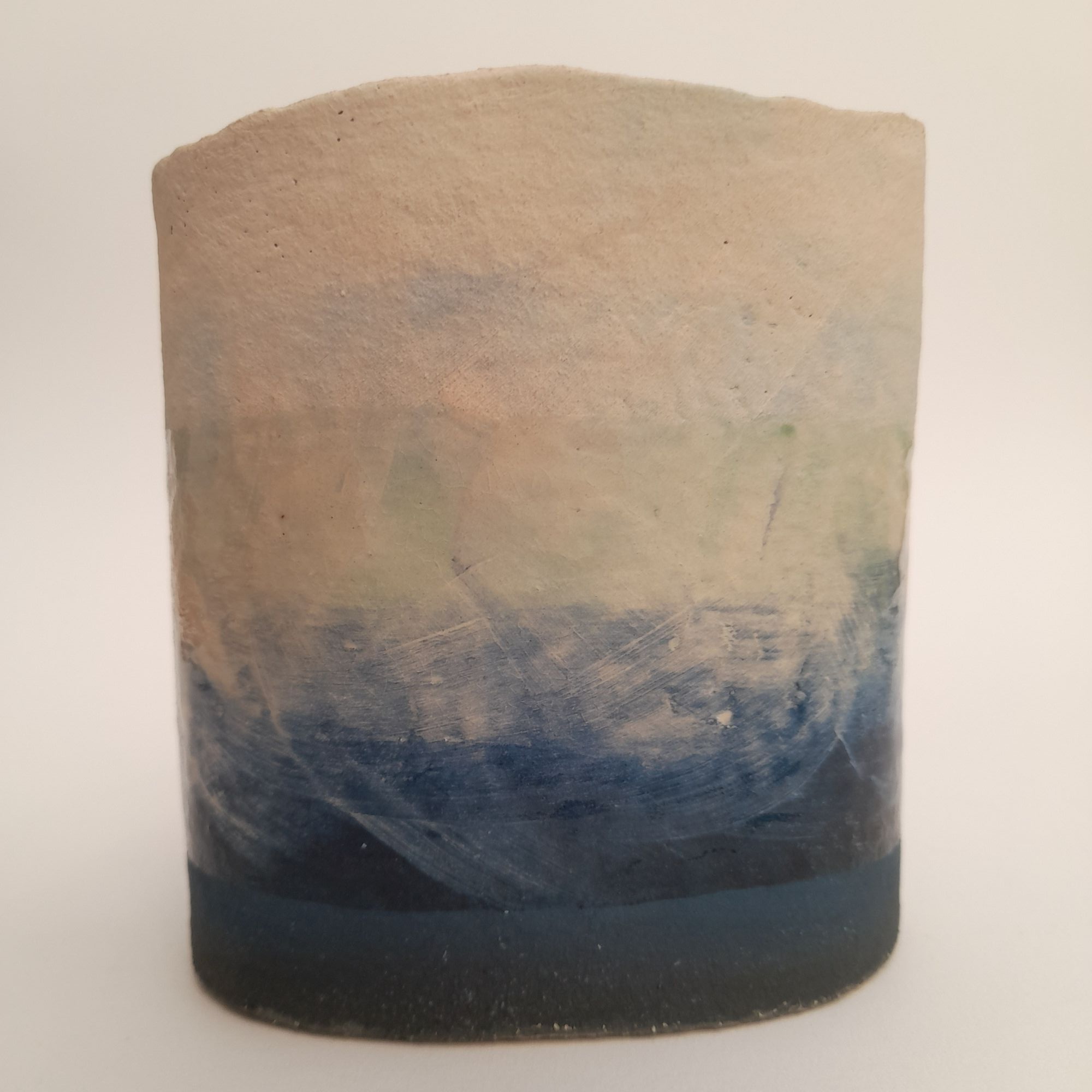 rough edged vase with seascape on sides