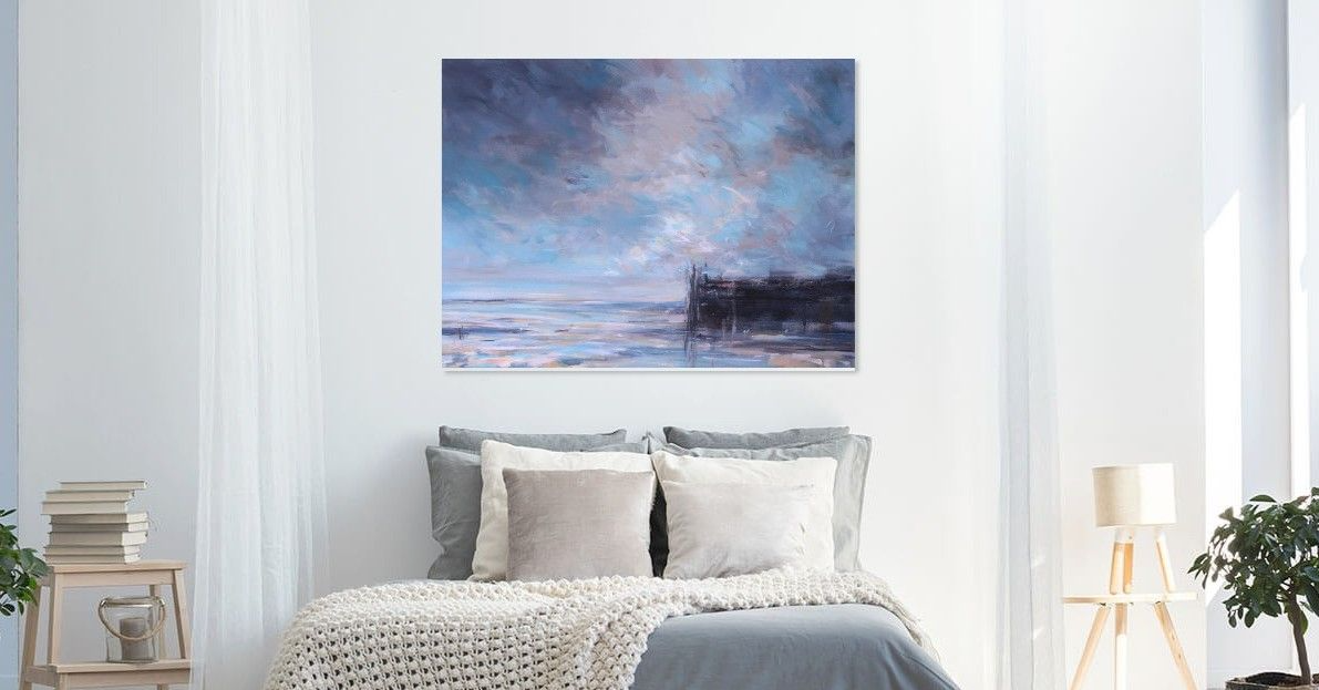 Big sky painting shown in bedroom setting