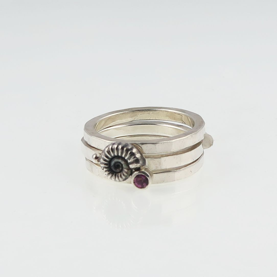 Ammonite stacking ring set with garnet
