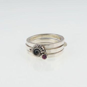 Ammonite stacking ring set with garnet